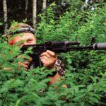 man-playing-in-lasertag-shooting-game-in-open-air--GEWUYL8